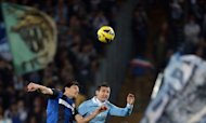 Lazio&#39;s forward Miroslav Klose (R) jumps for the ball with Inter Milan&#39;s defender Andrea Ranocchia during their Serie A football match in Rome&#39;s Olympic Stadium on December 15, 2012