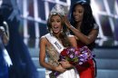 Miss Connecticut Erin Brady reacts as she is crowned by Miss USA 2012 Nana Meriwether during the Miss USA pageant in Las Vegas