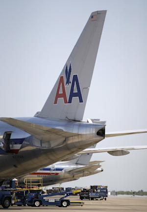 In this June 29, 2011 photo, American Airlines aircraft sit at Terminal D gates at Dallas-Fort Worth International Airport, in Grapevine, Texas. American Airlines and American Eagle's parent companies are filing for Chapter 11 bankruptcy protection Tuesday, Nov. 29, 2011.(AP Photo/Tony Gutierrez)