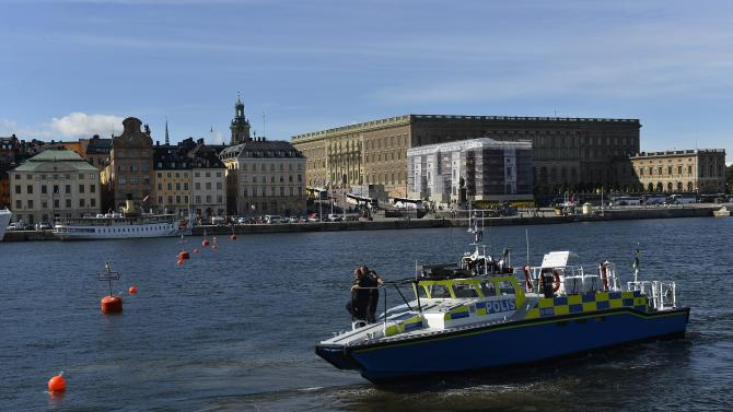 A police boat patrols the closed-off waters off the Stockholm Royal Palace, background right, in Stockholm, Tuesday Sept. 3, 2013, ahead of the scheduled visit by US President Barack Obama on upcoming Wednesday and Thursday. Police say up to 600 officers from around the country will provide security in the Swedish capital and large parts of downtown Stockholm will be closed off during the first bilateral visit to Sweden by a U.S. president. (AP Photo / Anders Wiklund) SWEDEN OUT
