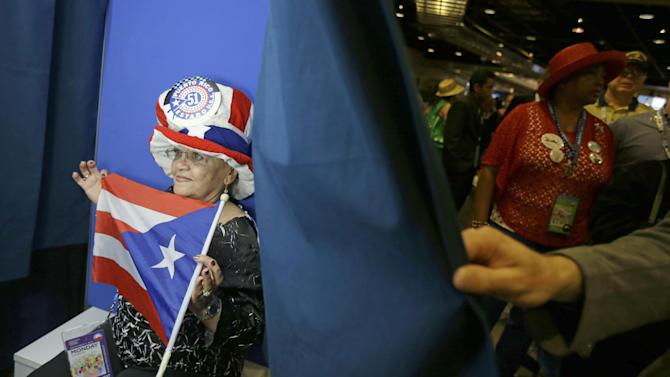 New York delegate Julia Rodriguez poses with Puerto Rico flag in a photo booth at the Democratic National Convention in Charlotte, N.C., on Wednesday, Sept. 5, 2012. (AP Photo/David Goldman)