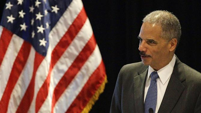 In this photo taken Tuesday, June 26, 2012, Attorney General Eric Holder speaks in Boston. With a vote looming to hold Holder in contempt of Congress, a House committee chairman is challenging President Barack Obama's claim of executive privilege, invoked to maintain secrecy for some documents related to a failed gun-tracking operation.   (AP Photo/Stephan Savoia)