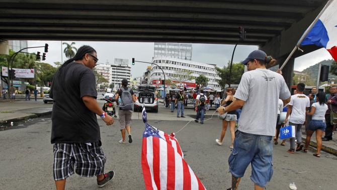 Protesters drag a U.S flag during a march marking the 25th anniversary of the U.S invasion of Panama in Panama City
