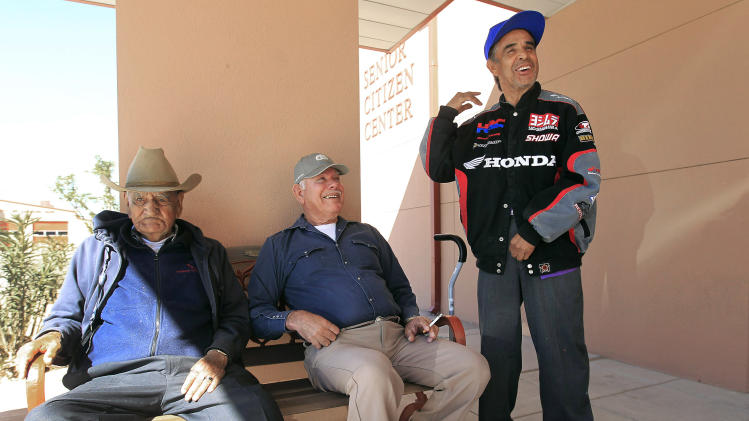 In this March 22, 2012 photo, Luis Valverde, right, talks with Nicho Vacca, middle, and Anthony Delgado, all long time residents of Sunland Park, as they gather in front of a senior center in Sunland Park, N.M. Scandal in this small border town is nothing new. But what is new is the harsh response: State and federal authorities are focusing on border town corruption as part of the larger effort to battle the influence of Mexican drug cartels. (AP Photo/Ross D. Franklin)
