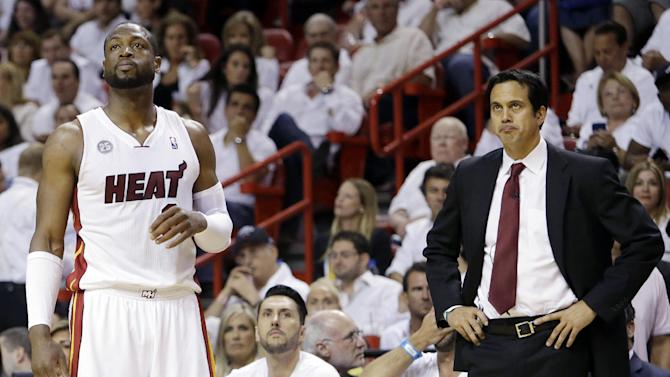 Miami Heat guard Dwyane Wade (3) and head coach Erik Spoelstra look up towards the scoreboard during the first half of Game 1 in their NBA basketball Eastern Conference finals playoff series against the Indiana Pacers, Wednesday, May 22, 2013 in Miami. (AP Photo/Lynne Sladky)