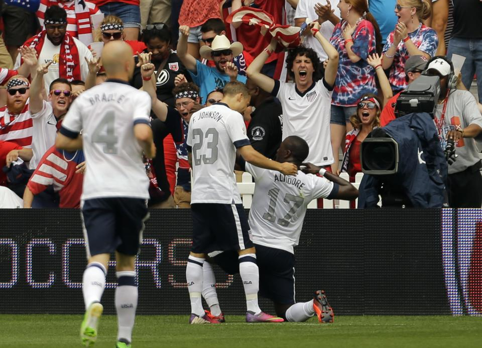 U.S. forward Jozy Altidore (17) celebrates with U.S. defenseman Fabian Johnson (23) after Altidore's goal during the first half of an international friendly soccer match against Germany at RFK Stadium Sunday, June 2, 2013, in Washington. (AP Photo/Alex Brandon)