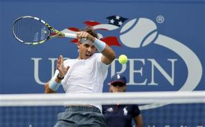 Nadal of Spain hits a return to Dodig of Croatia at the U.S. Open tennis championships in New York
