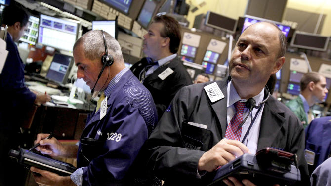FILE- In a Thursday, Aug. 9, 2012, file photo, trader Randy Beller, right, works on the floor of the New York Stock Exchange. The Standard & Poor's 500 index touched its highest point in more than four years Tuesday, Aug. 21, 2012, helped by more talk that the European Central Bank may buy struggling countries' bonds. But a morning rally faded, and stocks ended lower. (AP Photo/Richard Drew)