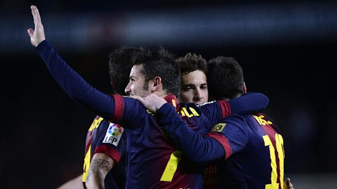 FC Barcelona's Lionel Messi, from Argentina, right, reacts after scoring with his teamamte Jordi Alba, center,and David Villa, left, against Rayo Vallecano during a Spanish La Liga soccer match at the Camp Nou stadium in Barcelona, Spain, Sunday, March 17, 2013. (AP Photo/Manu Fernandez)