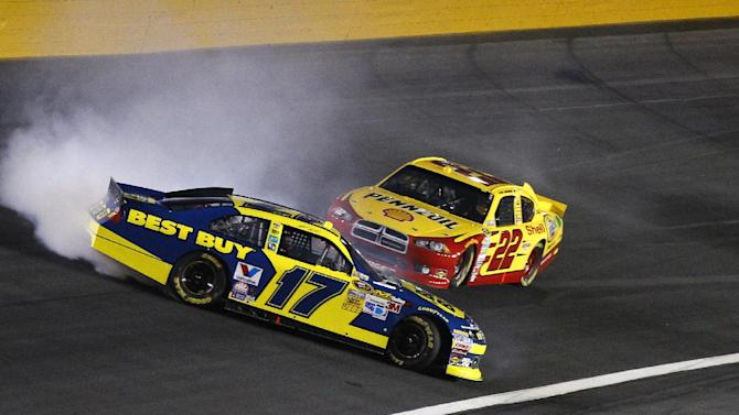 Matt Kenseth (17) spins as Sam Hornish Jr (22) tries to drive past during the NASCAR Bank of America 500 Sprint Cup series auto race in Concord, N.C., Saturday, Oct. 13, 2012. (AP Photo/Chuck Burton)