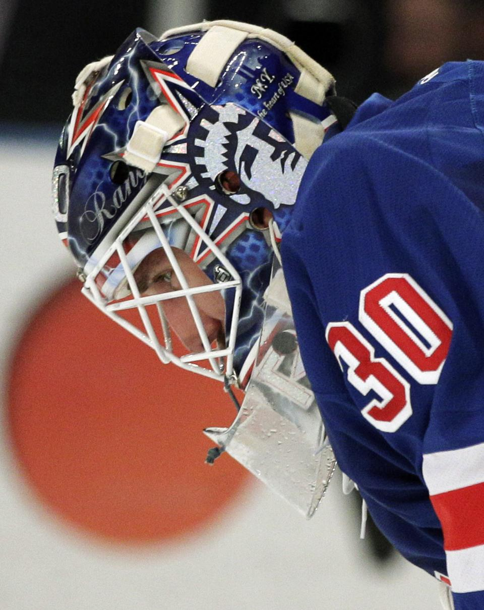 New York Rangers goalie Henrik Lundqvist, of Sweden, pauses during the first period of Game 5 of an NHL hockey Stanley Cup Eastern Conference final playoff series against the New Jersey Devils, Wednesday, May 23, 2012, in New York. (AP Photo/Frank Franklin II)