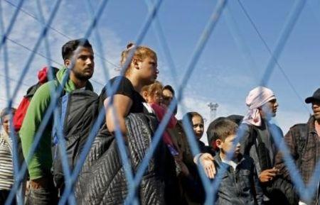 Migrants, hoping to cross into Croatia, wait for buses after arriving from Presevo by train, in Sid, Serbia