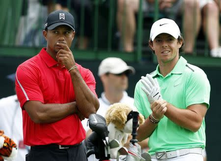 Tiger Woods of the U.S. talks to Rory McIlroy of Northern Ireland on the tee of the 12th hole during the final round of the Memorial Tournament at Muirfield Village Golf Club in Dublin in this file photo