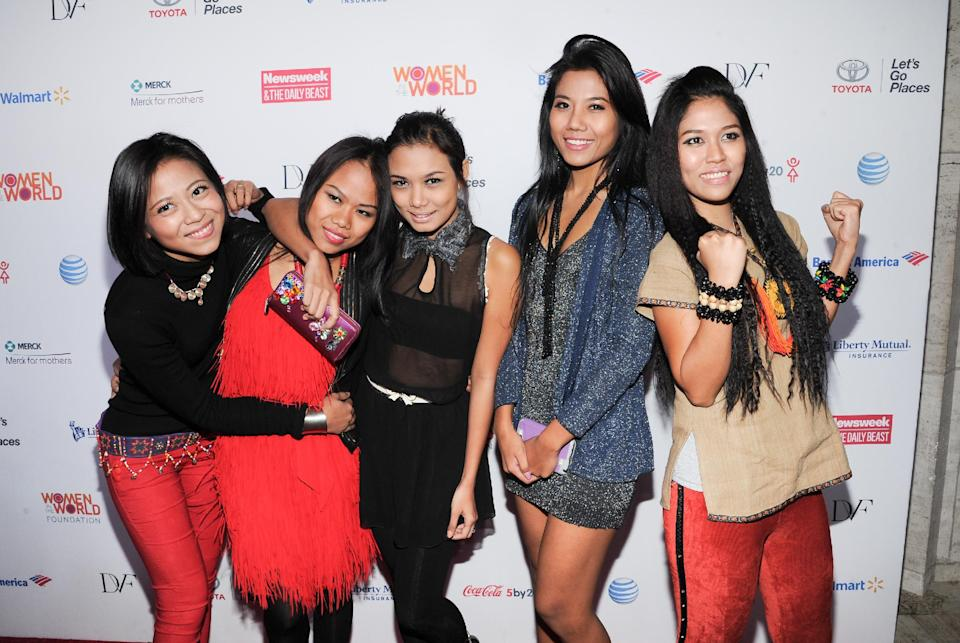 "Pop/hip-hop group and dance ensemble from Myanmar, ""Me N Ma Girls,"" attend the 4th Annual Women in the World Summit at the David H. Koch Theater on Thursday, April 4, 2013, in New York. (Photo by Evan Agostini/Invision/AP)"