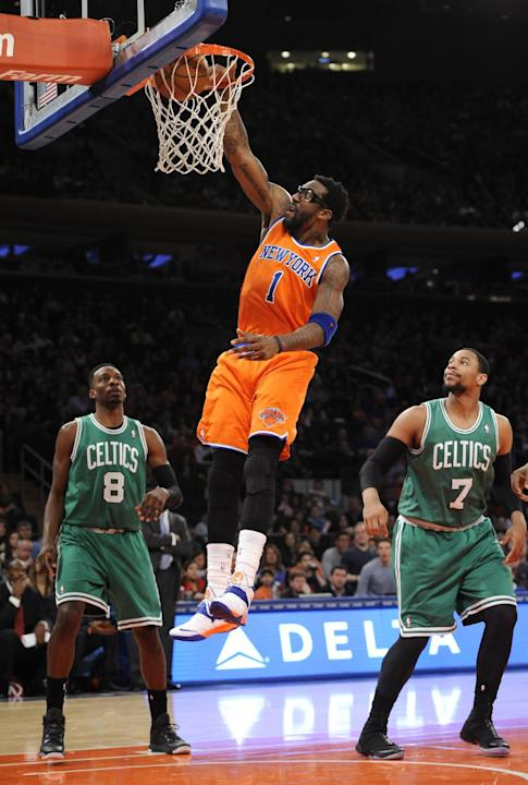 New York Knicks' Amar'e Stoudemire (1) shoots a basket between Boston Celtics' Jeff Green (8) and Jared Sullinger (7) during the first half an NBA basketball game on Sunday, Dec. 8, 2013,
