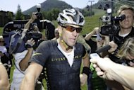 "Lance Armstrong speaks after finishing the Power of Four Mountain Bike Race on Aspen Mountain in Colorado last Saturday. Armstrong, branded a drug cheat by the US Anti-Doping Agency, said he was ""not afraid"" of any report USADA might make to the International Cycling Union"