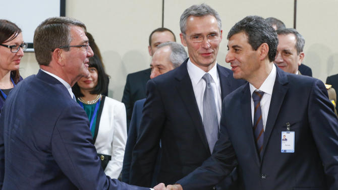 Delegates attend a NATO defence ministers meeting at the Alliance's headquarters in Brussels