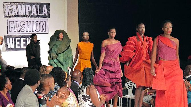 Models present creations made of bark cloth material by fashion designer Jose Hendo during the first fashion week show held in Kampala, on November 15, 2014