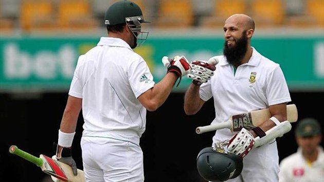 South Africa's Hashim Amla celebrates his century against Australia with team-mate Jacques Kallis (Reuters)