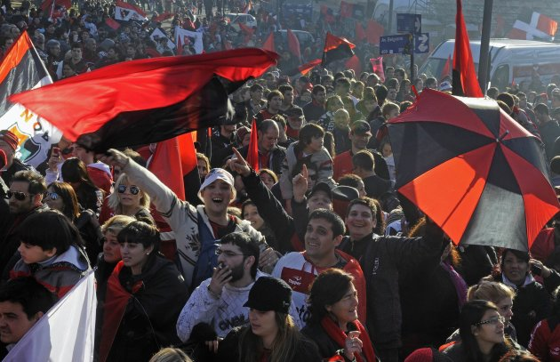 Soccer fans of Newell's Old Boys cheer after their team clinched the Argentina's First Division tournament in Rosario