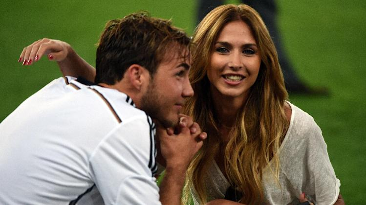 Germany's forward Mario Goetze celebrates with his wife after winning the 2014 FIFA World Cup final football match between Germany and Argentina 1-0 following extra-time at the Maracana Stadium in Rio de Janeiro, Brazil, on July 13, 2014