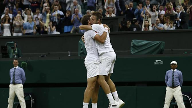 Canada's Vasek Pospisil (L) and US player Jack Sock celebrate winning their men's doubles final match against US players Bob and Mike Bryan at The All England Tennis Club in Wimbledon, southwest London, on July 5, 2014