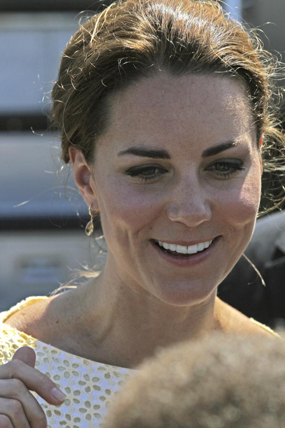 Britain's Kate, the Duchess of Cambridge, smiles as she and Prince William prepare to depart Honiara, Solomon Islands, Tuesday, Sept. 18, 2012, after an official visit to the South Pacific Island nation.  (AP Photo/Rick Rycroft)