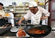A Peruvian chef prepares a dish based on shrimp and oyster sauce at a restaurant in Lima in 2006. Latin America's largest culinary festival, Mistura, attracts hundreds of thousands of foodies