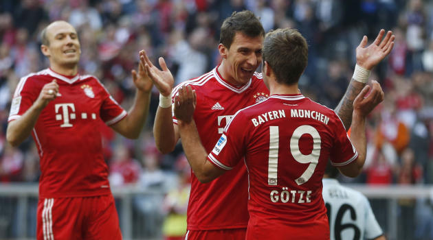 Bayern's Mario Mandzukic of Croatia, center, celebrates with team mate Mario Goetze after scoring his side's third goal during the German first division Bundesliga soccer match between FC Bayern Munic