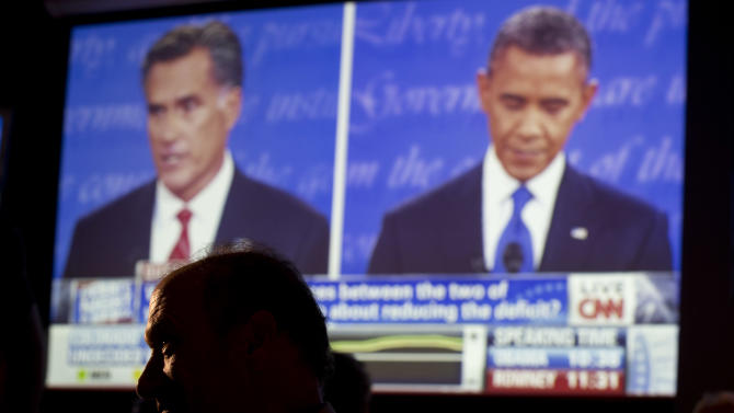 John Rossitto watches the first presidential debate between President Barack Obama and Republican presidential nominee Mitt Romney from a restaurant in San Diego, Wednesday, Oct. 3, 2012. (AP Photo/Gregory Bull)