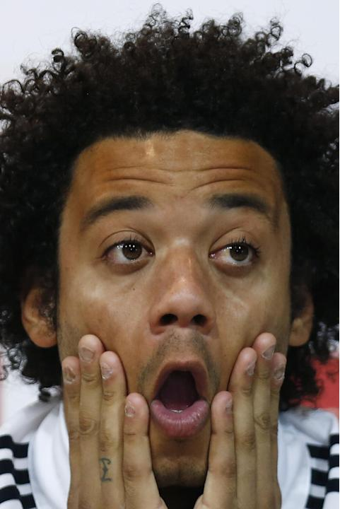 Real Madrid's Marcelo from Brazil gestures during a press conference on the 2014 soccer World Cup in Madrid, Spain, Sunday, Dec. 8, 2013