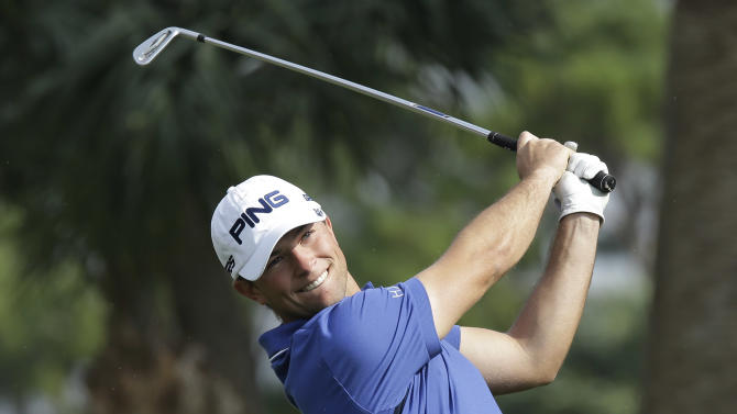 Luke Guthrie smiles as he watches his tee shot from the seventh  tee during the third round of the Honda Classic golf tournament in Palm Beach Gardens, Fla., Saturday, March 2, 2013. (AP Photo/J Pat Carter)