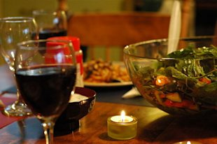 A glass of red wine is served with Moroccan salad.