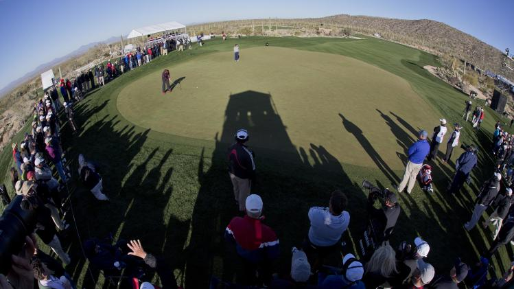 England's Ian Poulter Putts on the seventh green in the semifinal round of play against Hunter Mahan during the Match Play Championship golf tournament, Sunday, Feb. 24, 2013, in Marana, Ariz. (AP Photo/Julie Jacobson)
