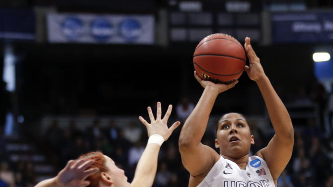 Connecticut forward Kaleena Mosqueda-Lewis (23) shoots over Texas guard Brady Sanders (32) during the first half of a women's college basketball regional semifinal game in the NCAA Tournament on Saturday, March 28, 2015, in Albany, N.Y. (AP Photo/Mike Groll)