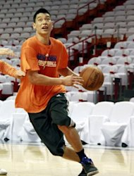Jeremy Lin of the New York Knicks trains with his team ahead of the first round of the NBA playofffs against the Miami Heat on April 28. Lin was careful Sunday not to promise a first-round return