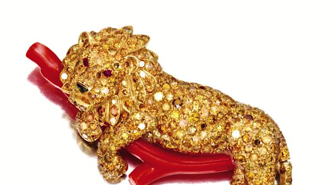 This undated photo provided by Sotheby's shows a gold, a colored diamond, coral and ruby lion brooch  that belonged to the late philanthropist Brooke Astor. Sotheby's said the piece will be offered at a New York auction of the late philanthropist's personal items which will include some 800 items to be offered Sept. 24-25 from Astor's Park Avenue duplex and her stone manor in Westchester. (AP Photo/Sotheby's)