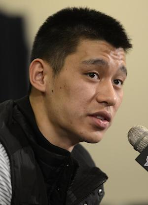 Houston Rockets' Jeremy Lin speaks to the media at a news conference prior to an NBA basketball game  between the Rockets and the New York Knicks at Madison Square Garden in New York, Monday, Dec. 17, 2012. (AP Photo/Henny Ray Abrams)