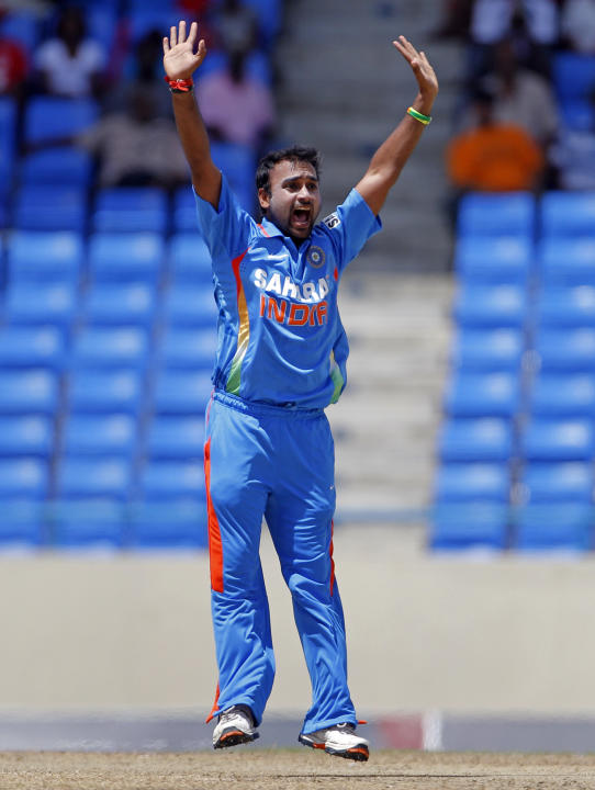 India's bowler Amit Mishra successfully appeals for the LBW of West Indies' Marlon Samuels, to dismiss him for 8 runs, during their fourth one-day international cricket match in St. John's