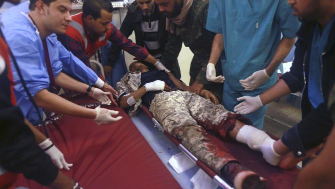 An injured Libyan military personnel receives medical treatment at the Benghazi Medical Center