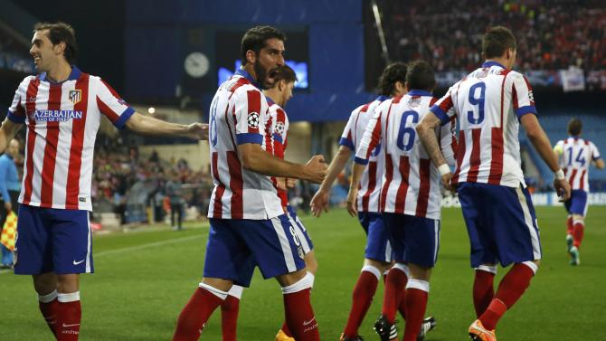 Atletico Madrid's Raul Garcia celebrates after scoring a goal against Olympiakos during their Champions League Group A soccer match in Madrid