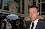 "Chelsea and England footballer John Terry leaves after attending the second day of his trial at Westminster Magistrates court in London. Terry took the witness stand Tuesday and told his trial that he was ""very angry and upset"" when he thought an opponent had accused him of making racist remarks"