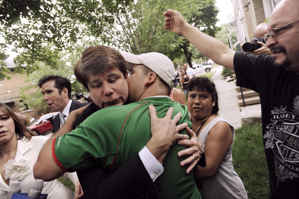 Former Illinois Gov. Rod Blagojevich left, hugs a supporter as he leaves his home Monday, June 27, 2011, in Chicago, heading to the federal court after jurors informed the judge that they had reached agreement on 18 of the 20 counts against him in his corruption retrial. (AP Photo/Paul Beaty)