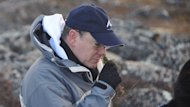 Prince Albert of Monaco learns about the plants of the tundra Thursday in Iqaluit.