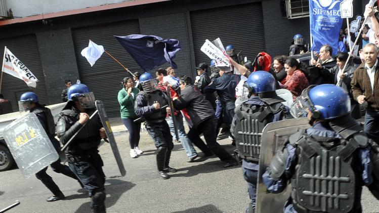 Public school teachers clash with police during a march held as part of a national strike by the teachers in Asuncion