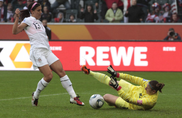 United States' Alex Morgan fails to score past France goalkeeper Berangere Sapowicz during the semifinal match between France and the United States at the Women's Soccer World Cup in Moenchengladbach,