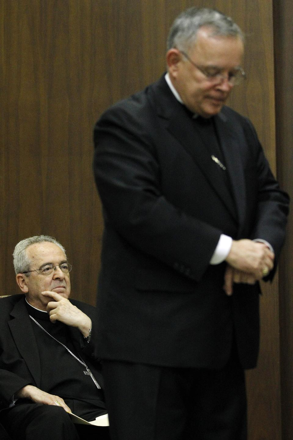 Cardinal Justin Rigali, left and Denver Archbishop Charles Chaput are seen during a news conference Tuesday, July 19, 2011, in Philadelphia. The Vatican on Tuesday named Chaput as Rigali's successor as Archbishop of Philadelphia. (AP Photo/Matt Rourke)