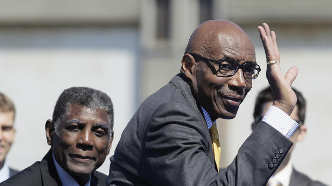 Golden State Warriors greats Al Attles, left, and Nate Thurmond, right, wave during an announcement Tuesday, May 22, 2012, in San Francisco, that the NBA basketball team wants to return to San Francisco. The Warriors unveiled plans to build an arena at Piers 30-32. The waterfront site near the San Francisco-Oakland Bay Bridge is just blocks from the San Francisco Giants' ballpark and the downtown financial district. Both Attles and Thurmond played for the Warriors when they were previously in San Francisco. (AP Photo/Eric Risberg)