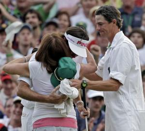 **CORRECTS MOTHERS NAME TO MOLLY** Bubba Watson hugs his mother Molly along with caddie Ted Scott after winning the Masters golf tournament following a sudden death playoff on the 10th hole Sunday, April 8, 2012, in Augusta, Ga.  (AP Photo/Chris O'Meara)