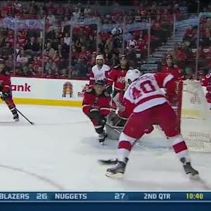 Henrik Zetterberg is set up by Todd Bertuzzi